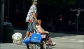 onward trusty faithful steed man standing back wheelchair street funny pics pictures pic picture image photo images photos lol
