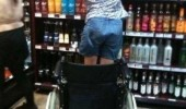 miracle in alcohol isle woman standing wheelchair reaching bottles funny pics pictures pic picture image photo images photos lol
