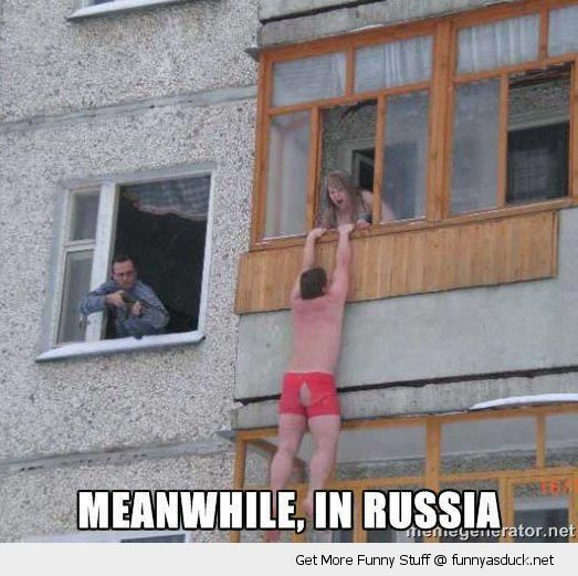 man hanging out window ledge pants underwear building gun rifle meanwhile russia funny pics pictures pic picture image photo images photos lol