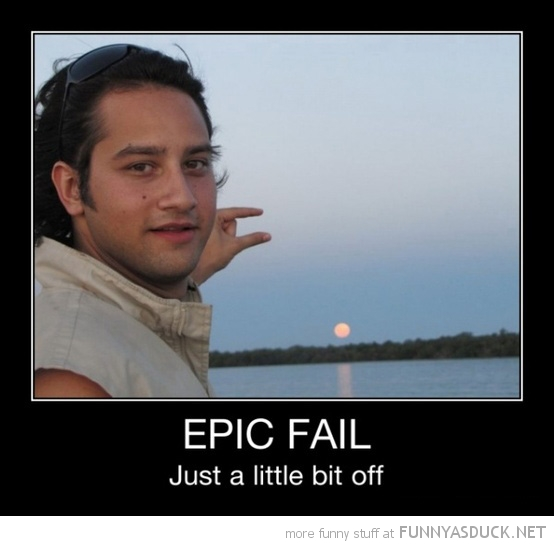 man catching sun between fingers epic fail funny pics pictures pic picture image photo images photos lol