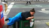 fat woman newspaper stand lying down eat pickle new york funny pics pictures pic picture image photo images photos lol