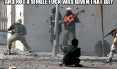 man playing guitar was soldiers shooting gun not single fuck given funny pics pictures pic picture image photo images photos lol