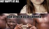 soiled little girl kid not happy african boy rock as camera funny pics pictures pic picture image photo images photos lol