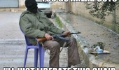 terrorist sitting down gun go ahead i'll liberate this chair funny pics pictures pic picture image photo images photos lol