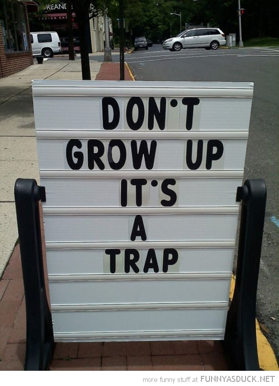 don't grow up it's a trap sign funny pics pictures pic picture image photo images photos lol