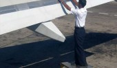 man fixing airplane wing duct tape funny pics pictures pic picture image photo images photos lol