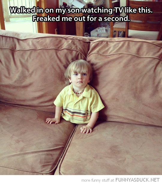 kid boy stuck down sofa watching tv funny pics pictures pic picture image photo images photos lol